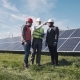 Workers Walking In Beside Row Of Solar Panels - VideoHive Item for Sale