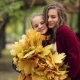Two Sisters Hug, With a Bunch Of Leaves In The Park. - VideoHive Item for Sale