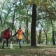 Two Young Women Running Hand In Hand, And Dog Fox Terrier. Jogging In The Autumn Forest. Falling - VideoHive Item for Sale