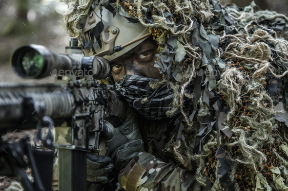 sniper wearing ghillie suit - Stock Photo - Images