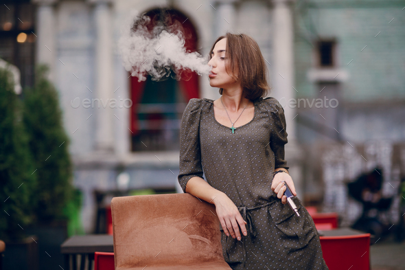 girl with E-cigarette - Stock Photo - Images