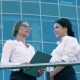 Two Friendly Female Coworkers Doing Business Outdoors - VideoHive Item for Sale