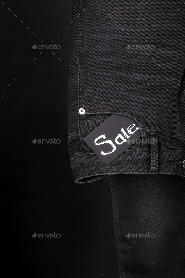 sale.Friday. Close up of black jeans with sign  on  background. - Stock Photo - Images