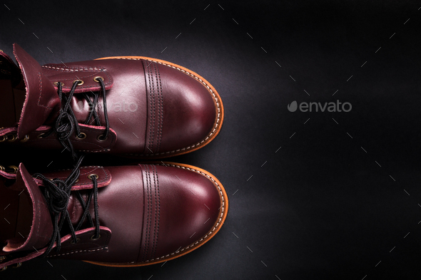 Fashionable mens leather brown shoes on black background. . Men's high boots. Top view. Copy space. - Stock Photo - Images