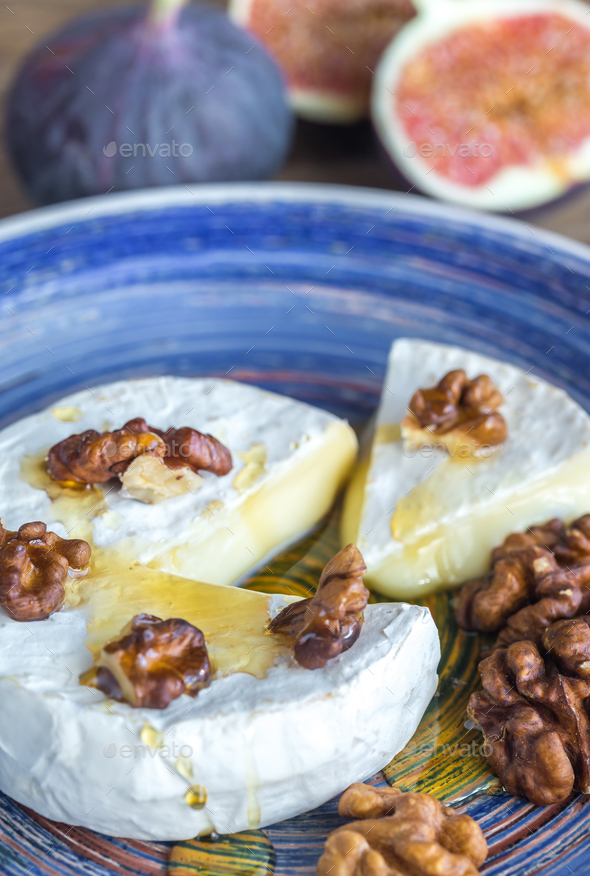 Camembert, figs and walnuts - Stock Photo - Images