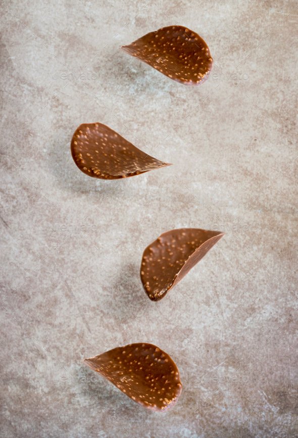 Falling chocolate chips - Stock Photo - Images