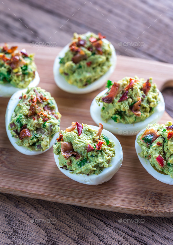 Bacon guacamole deviled eggs - Stock Photo - Images