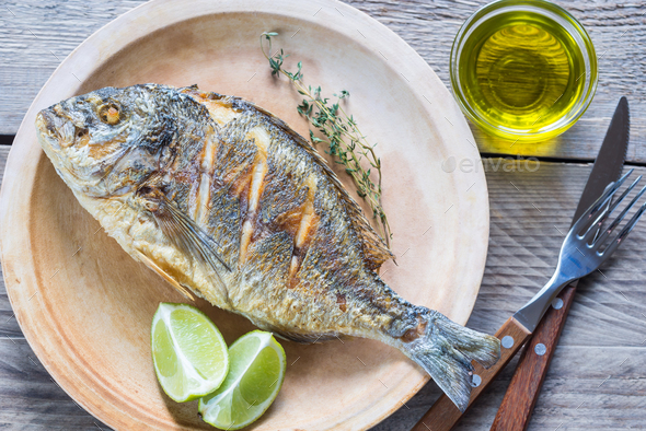 Grilled Dorade Royale Fish on the plate - Stock Photo - Images