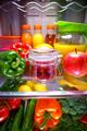 Fresh raspberries in a glass jar on a shelf open refrigerator - PhotoDune Item for Sale