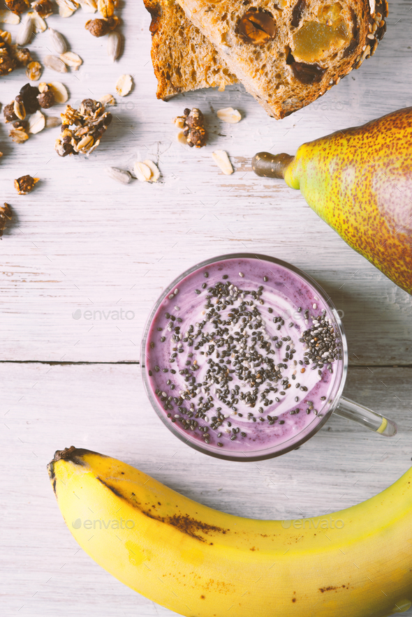 Farm yogurt with chia in a jar, granola, banana - Stock Photo - Images