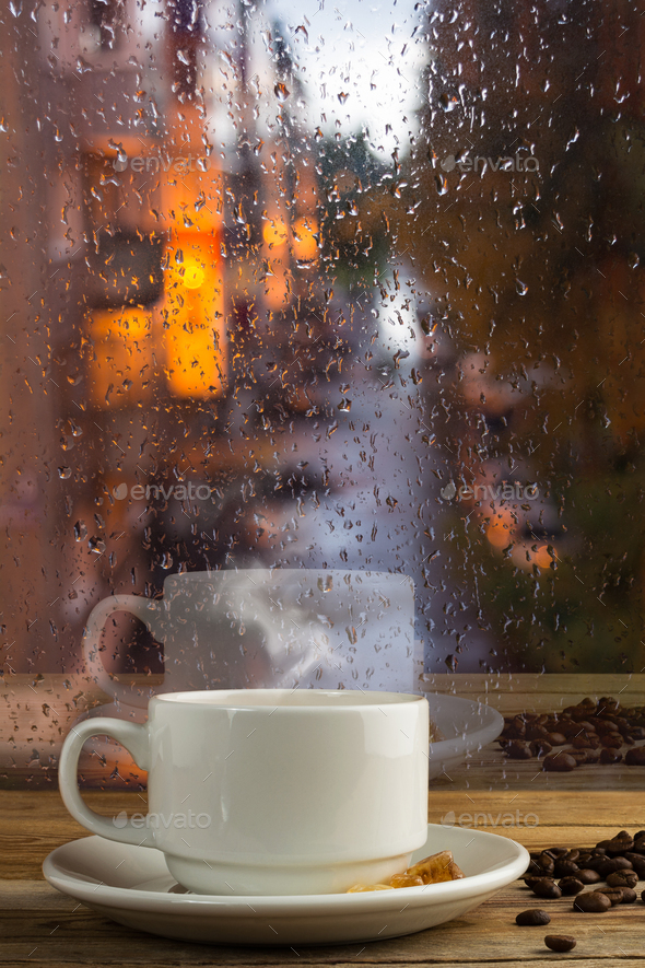 Cup of strong coffee on the rainy window background - Stock Photo - Images
