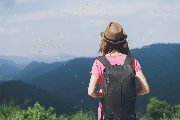 Woman traveler looking at the mountain - Stock Photo - Images