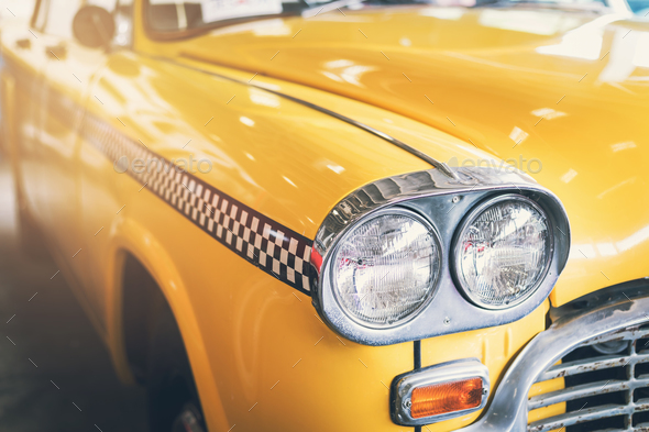 Close up headlight of yellow Retro classic car - Stock Photo - Images
