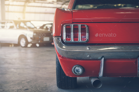 Close up rear view of red Retro classic car - Stock Photo - Images