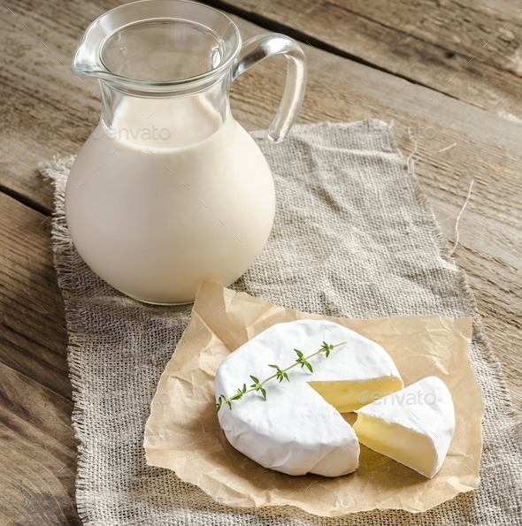 Camembert with pitcher of milk - Stock Photo - Images