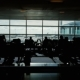 Tracking Shot Of a Large Airport Terminal. Silhouettes Of Passengers Waiting For Their Flight - VideoHive Item for Sale