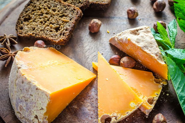 Mimolette with hazelnuts - Stock Photo - Images