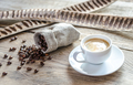 Cup of coffee with coffee beans