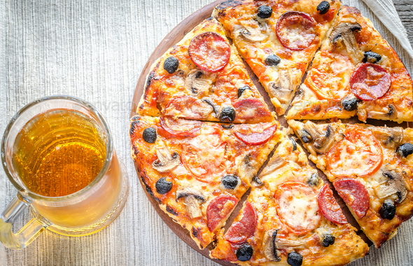Homemade pizza with a glass of beer - Stock Photo - Images