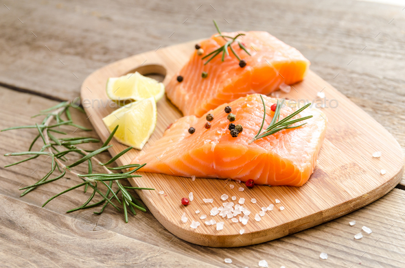 Raw salmon steaks on the wooden board - Stock Photo - Images