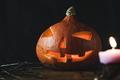 Halloween pumpkin Jack-o-lantern on the dark background