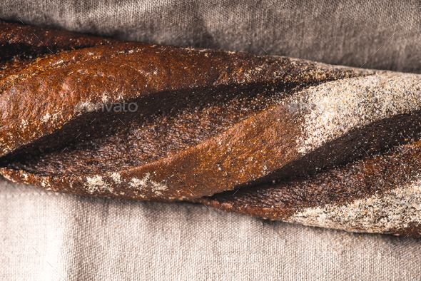 Baguette on the grey napkin horizontal - Stock Photo - Images