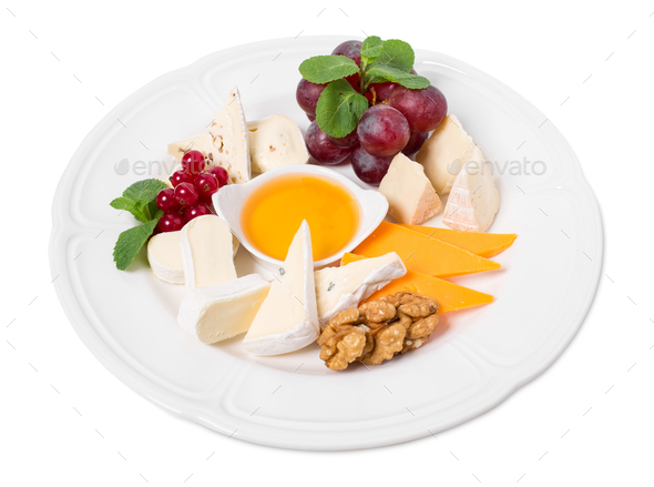 Delicious cheese platter with walnuts and honey. - Stock Photo - Images