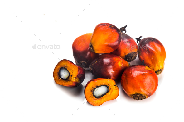 Heaps of freshly harvested oil palm fruits on white background. - Stock Photo - Images