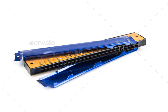 Broken harmonica cover plate isolated in white background - Stock Photo - Images