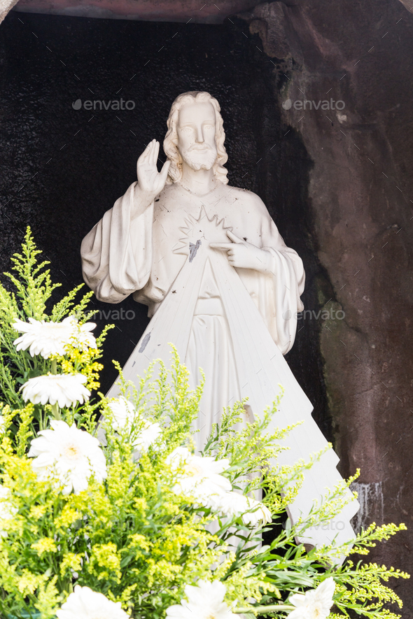 Statue of Jesus Christ in grotto of a Catholic Church - Stock Photo - Images