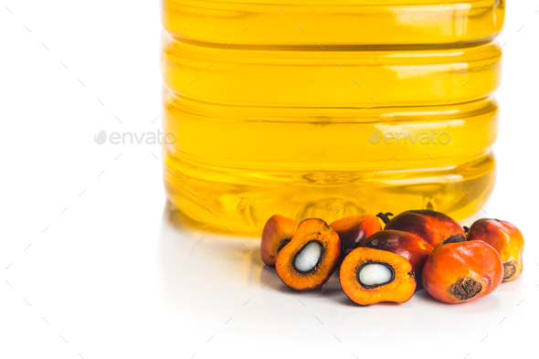 Refined palm oil in bottle with fresh oil palm fruits. - Stock Photo - Images