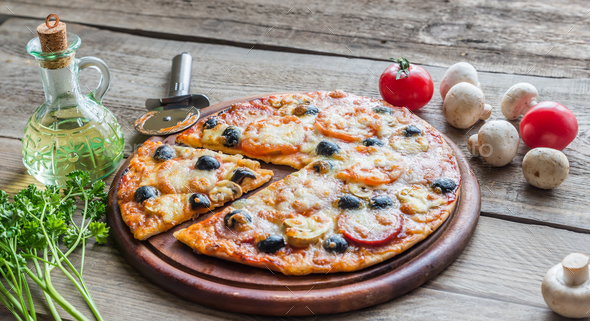 Cooked pizza on the wooden board - Stock Photo - Images