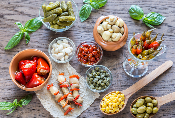Pickled vegetables on the wooden background - Stock Photo - Images