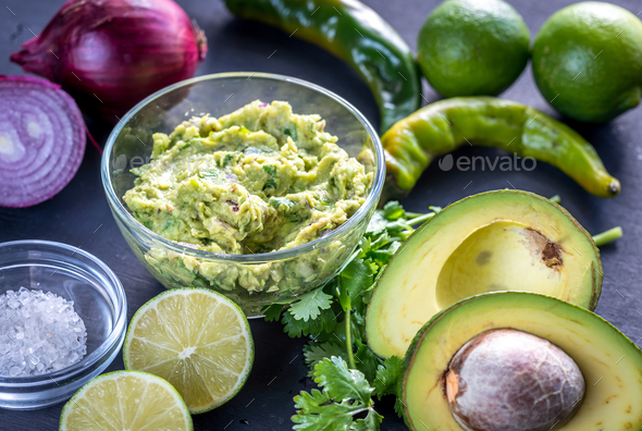 Guacamole with ingredients - Stock Photo - Images