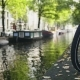 View Of Wheel Of Bicycle On The Amsterdam Canal, Sunny Day - VideoHive Item for Sale
