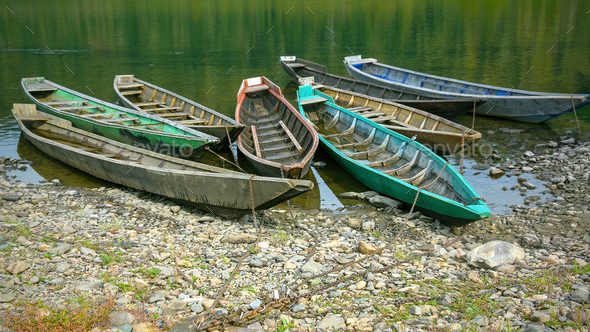 Old wooden boats moored to the bank of the river - Stock Photo - Images