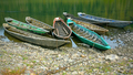 Old wooden boats moored to the bank of the river - PhotoDune Item for Sale