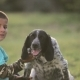 Boy Ans Dog Sitting On The Lawn - VideoHive Item for Sale