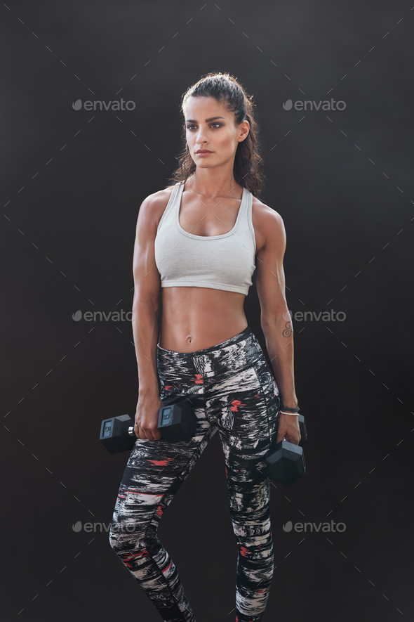 Muscular sportswoman with dumbbells - Stock Photo - Images