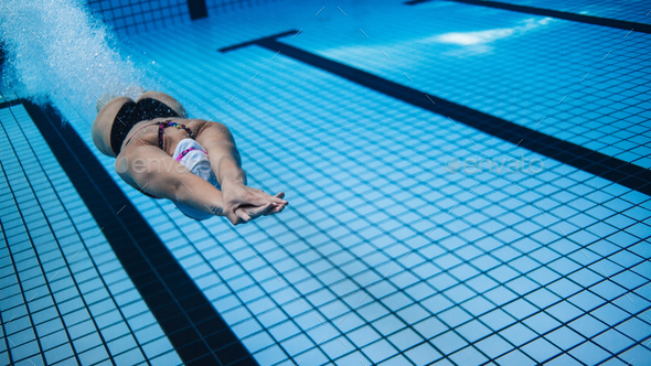 Woman training in swimming pool - Stock Photo - Images