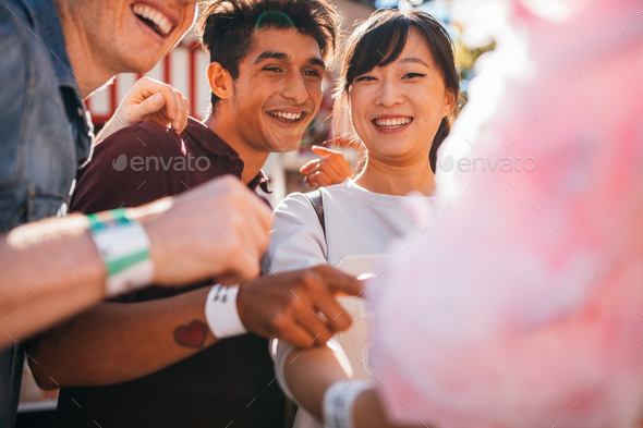 Friends with cotton candy outdoors - Stock Photo - Images