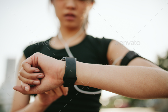 Fitness female monitoring her performance on smartwatch - Stock Photo - Images