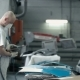 Man Changes The Nozzle On a Grinding Machine. - VideoHive Item for Sale