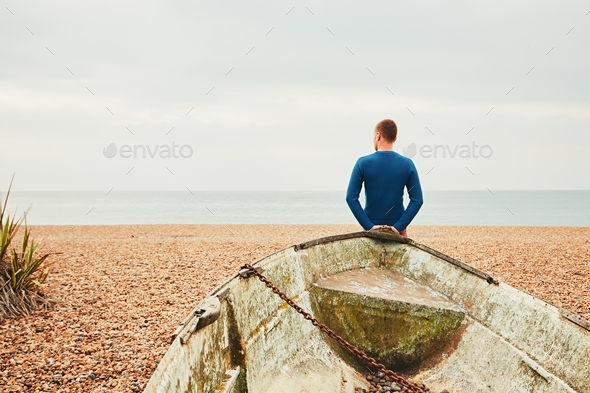 Alone and pensive man on the beach - Stock Photo - Images