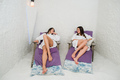 Two women relaxing in a salt cave at Halotherapy