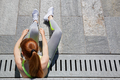 Woman tying shoelaces before running outdoor in the city - PhotoDune Item for Sale