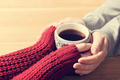 A couple in love warming hands with a hot mug of tea - PhotoDune Item for Sale