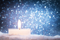 Chistmas candle glowing on wooden wall background. - PhotoDune Item for Sale