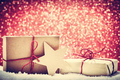Retro rustic Christmas gifts, presents in snow on glitter background - PhotoDune Item for Sale