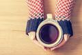 Hot mug of tea warming woman's hands in retro jumper. - PhotoDune Item for Sale